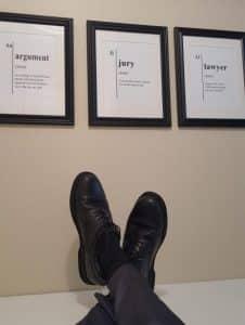 lawyer feet on desk